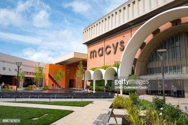 Macy's department store on a sunny day with a cloudy blue sky at the Stanford Shopping Center an upscale outdoor shopping mall in the Silicon Valley...