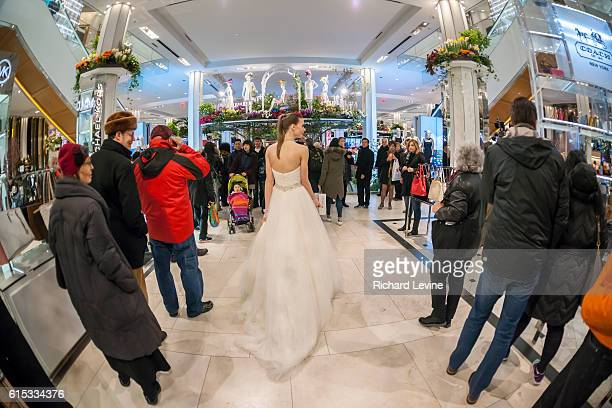 A Macy's model poses for visitors in Macy's flagship department store in Herald Square in New York during the 42nd annual Macy's Flower Show on...