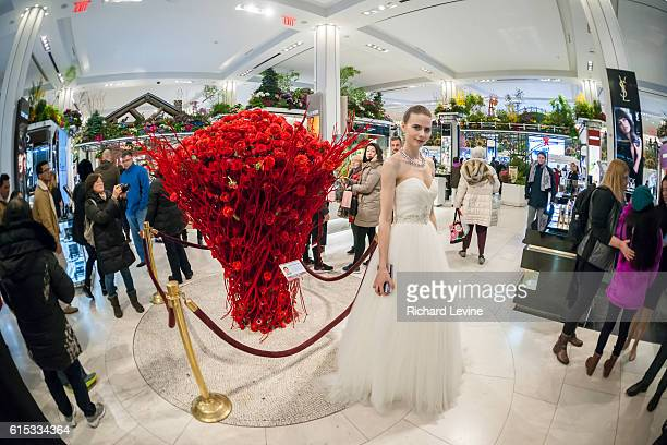 A Macy's model poses in front of the Bouquet of the Day by Kenji Takenada in Macy's flagship department store in Herald Square in New York during the...