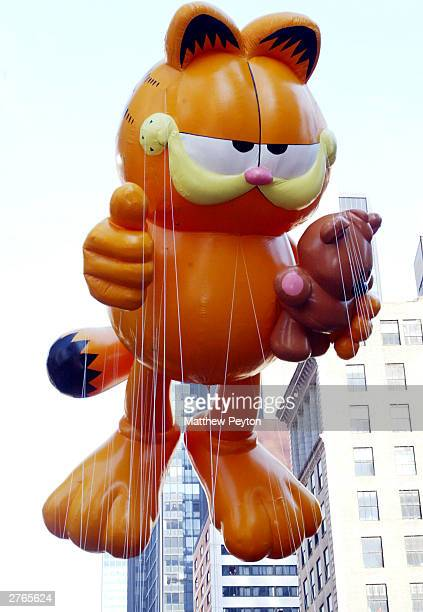 Macy's new holiday ambassador 'Paws Incorporated' display their Garfield balloon at The 77th Annual Macys Thanksgiving Day Parade on November 27 2003...