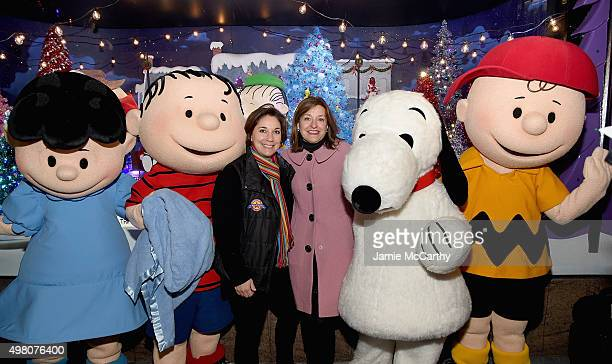 Macy's Thanksgiving Day parade Executive Producer Amy Kule and Macy's National Director of Window Presentation Roya Sullivan pose with The Peanuts in...