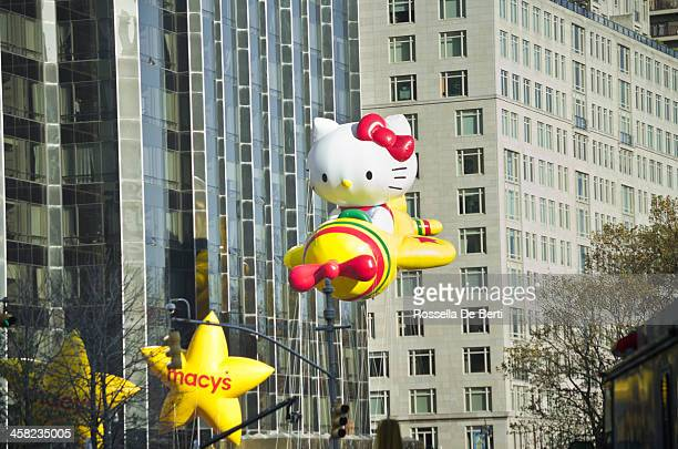 macy's thanksgiving day parade, hello kitty and stars - thanksgiving parade stock photos and pictures