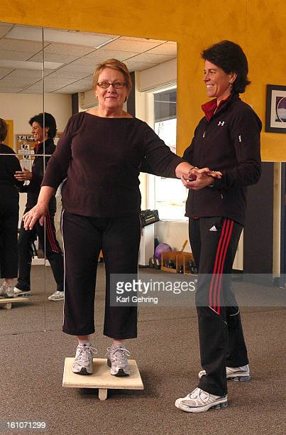 FE17FTBALANCE Mad About Fitness owner Jane Hastings right assisted Rosie Mahoney left as she worked out on a balance board Hasting's exercise studio...