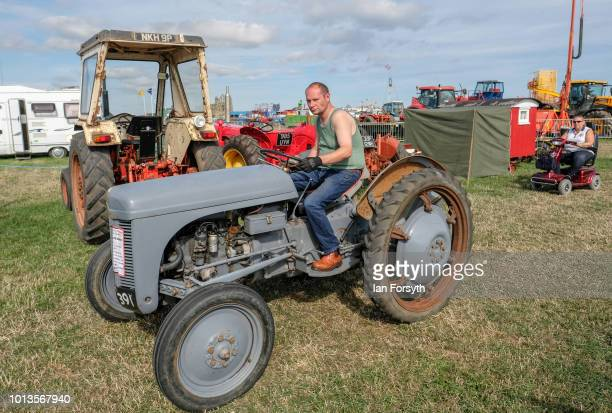 Mad drives his vintage tractor into the display area during the final day of the Whitby Traction Engine Rally on August 5, 2018 in Whitby, England....