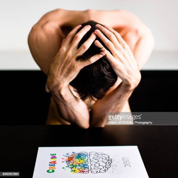 mad man depressed patient takes his head in his hands - paris fury stock pictures, royalty-free photos & images