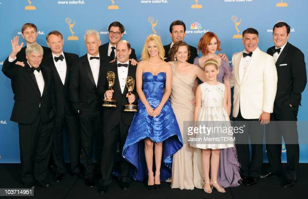 Mad Men cast and crew members winners of the Outstanding Drama Series Award pose in the press room at the 62nd Annual Primetime Emmy Awards held at...