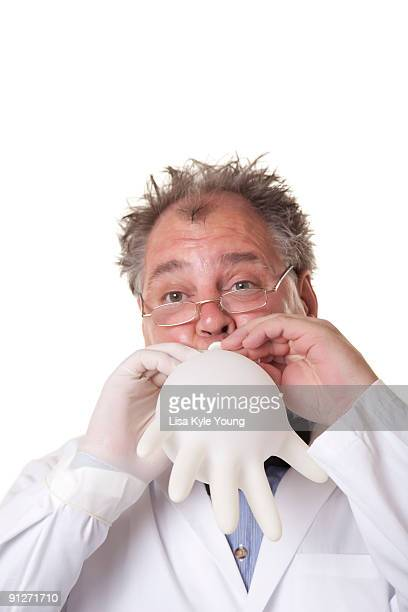 Mad Scientist blowing up rubber glove