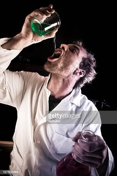 mad scientist drinking potion - potion stock photos and pictures