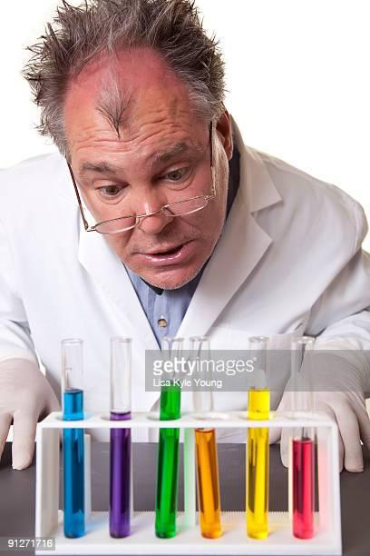 Mad Scientist examining his creations