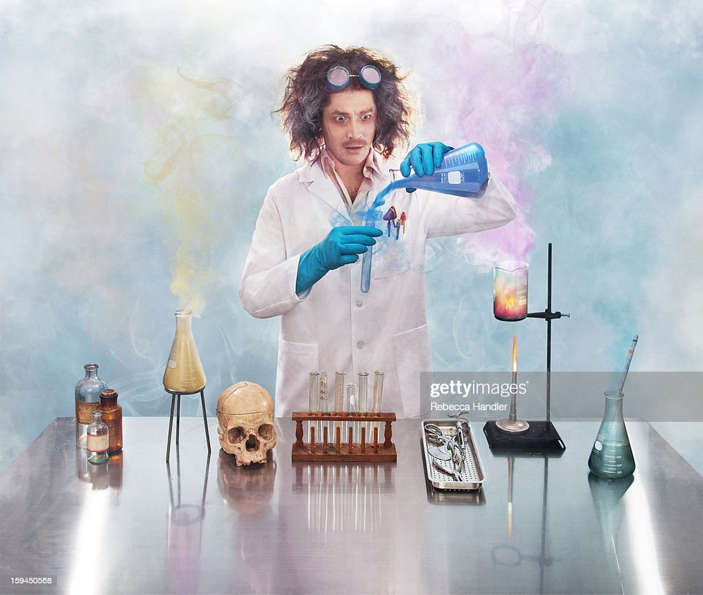 Mad scientist in lab with smoke : Stock Photo