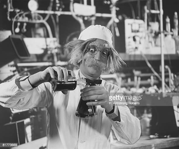 Mad scientist in laboratory, mixing chemicals.