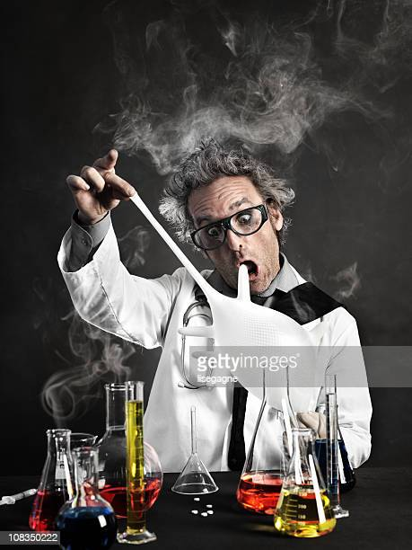 mad scientist playing with gloves - mad scientist stock photos and pictures