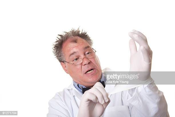 Mad Scientist playing with rubber gloves