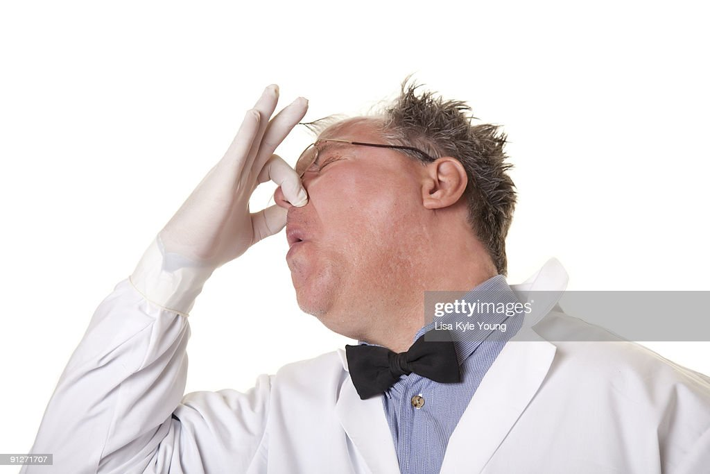 Mad Scientist Smelling Something Bad Stock Photo