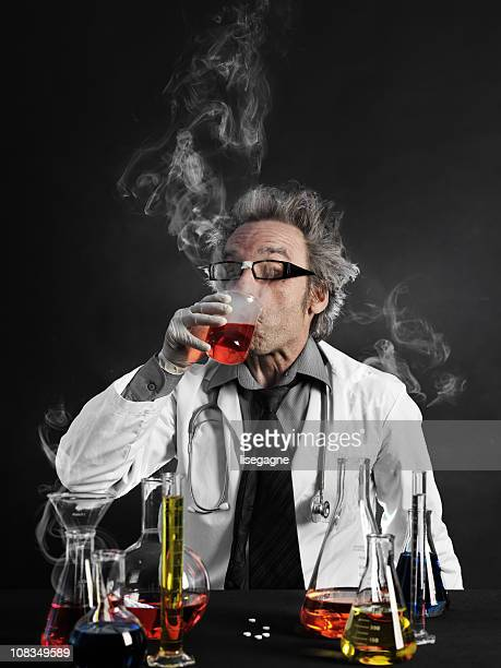 Mad scientist tasting liquid