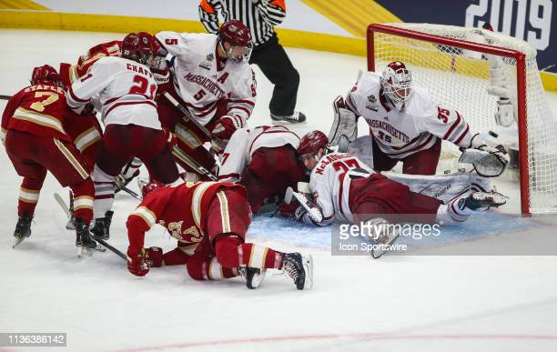 Mad scramble in front of Massachusetts Minutemen Goaltender Flip Lindberg as the puck end up in the back of the net during the NCAA Frozen Four men's...