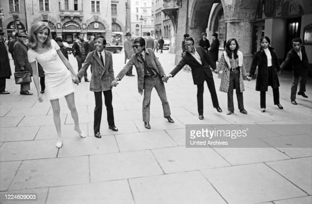 "Madagascan pop band ""Les Surfs"" with actress Marika Mindszenty, Germany, 1960s."