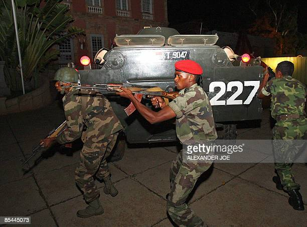 Madagascan soldiers loyal to opposition leader Andry Rajoelina check the area during the take-over of the office of President Marc Ravalomanana on...
