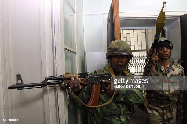 Madagascan soldiers loyal to opposition leader Andry Rajoelina participate in the takeover of the offices of President Marc Ravalomanana in...