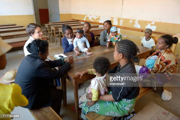 Madagascar, Fianarantsoa, Young mothers and their babies in mother and child group