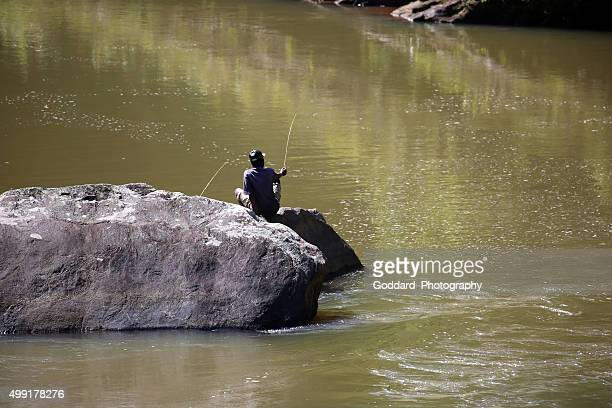 madagascar: fishing in the namorona river - ranomafana national park stock photos and pictures