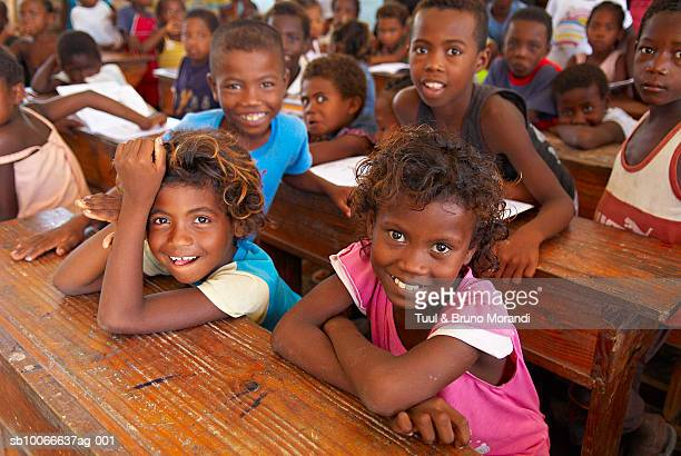 madagascar, ifaty, children (6-11 years) sitting in classroom, portrait, elevated view - madagascar enfant photos et images de collection