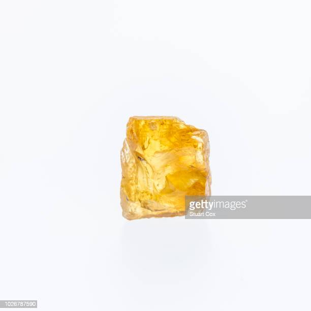 Madagascar Natural Rough Raw Yellow Beryl Heliodor Crystal on a white background.