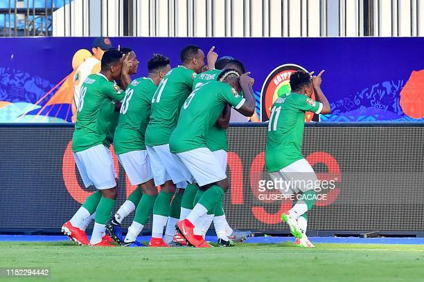 Madagascar players cebrate a goal during the 2019 Africa Cup of Nations football match between Madagascar and Burundi at the Alexandria Stadium on...