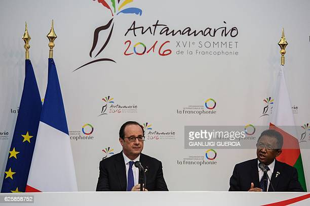 Madagascar President Hery Rajaonarimampianina and French President Francois Hollande give a press briefing after the official opening of the XVI...