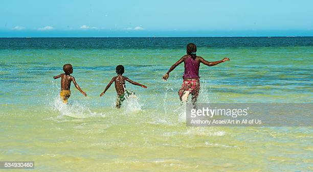 Madagascar Tulear Ifaty children running into the turquoise water