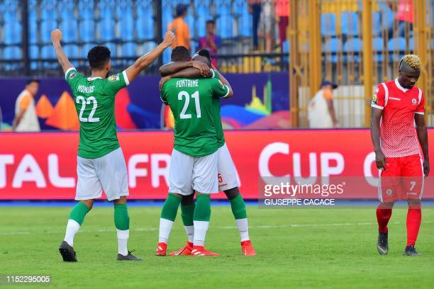 Madagascar's defender Jerome Mombris , Madagascar's defender Thomas Fontaine and Madagascar's defender Pascal Razakanantenaina celebrate after...