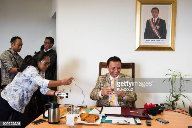 Madagascar's former president Marc Ravalomanana serves himself some juice during a press conference at his home in Antananarivo, on January 9 ahead...