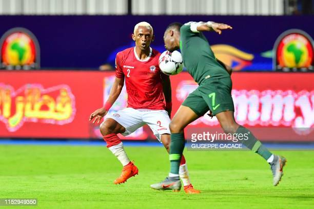 Madagascar's forward Charles Andriamahitsinoro vies for the ball with Nigeria's forward Ahmed Musa during the 2019 Africa Cup of Nations Group B...