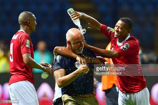 Madagascar's forward Faneva Andriatsima and Madagascar's forward Tsilavina Njiva pour water on Madagascar's coach Nicolas Dupuis as they celebrate...