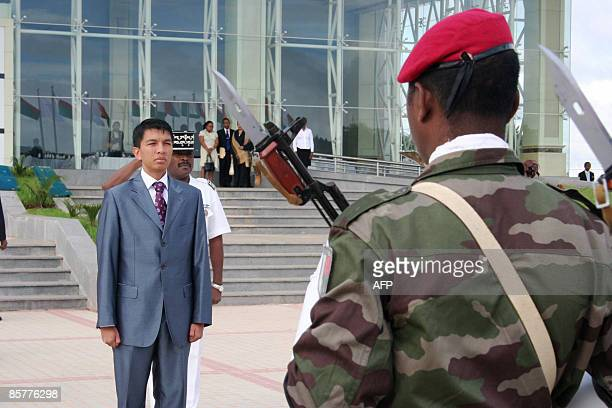 Madagascar's interim president Andry Rajoelina is saluted by an honour guard moments after arriving at a conference centre on April 2 2009 where a...