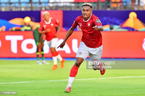 Madagascar's midfielder Lalaina Nomenjanahary celebrates after scoring a goal during the 2019 Africa Cup of Nations Group B football match between...