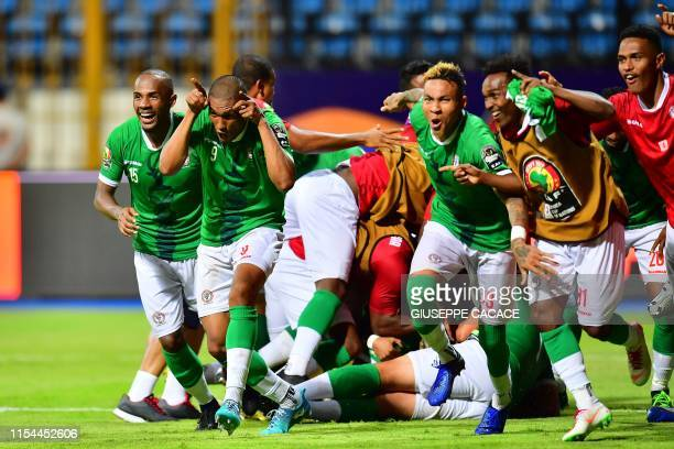 Madagascar's players celebrate their win during the 2019 Africa Cup of Nations Round of 16 football match between Madagascar and DR Congo at the...