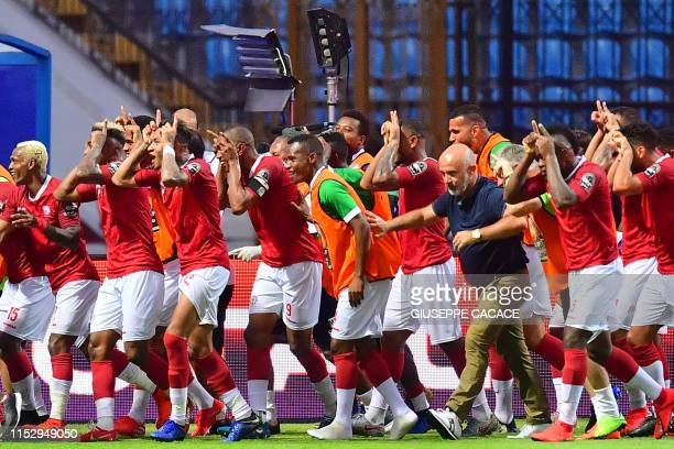 Madagascar's players celebrates after scoring their second goal during the 2019 Africa Cup of Nations Group B football match between Madagascar and...