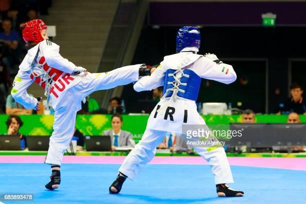 Madahi Fatemeh of Iran and Yildirim Rukiye of Turkey compete in the Women's 46kg Taekwondo Semfinal during day five of the Baku 2017 4th Islamic...