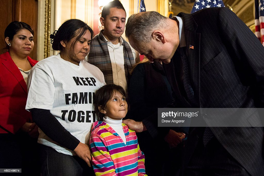 Madai Ledezma, 32, from Mexico, now living in Maryland, and her daughter Heather Pina-Ledezma, 6, are greeted by Sen. Charles Schumer (D-NY) after he spoke during a news conference to discuss U.S. President Barack Obama's executive order on immigration, on Capitol Hill, December 10, 2014 in Washington, DC. President Obama traveled to Nashville, Tennessee on Tuesday, where he defended his actions on immigration and again called on Congress to pass an immigration bill.