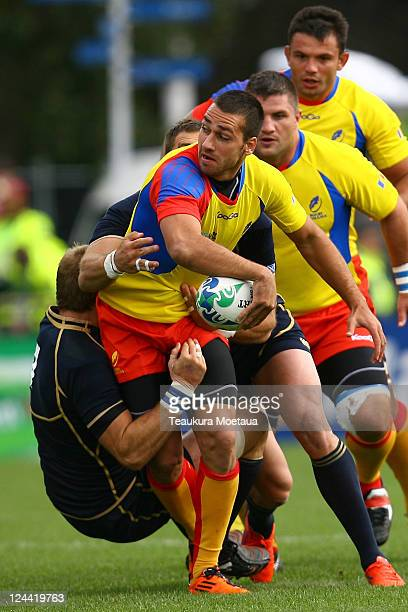 Madalin Viad Lemnaru of Romania is tackled during the IRB 2011 Rugby World Cup Pool B match between Scotland and Romania at Rugby Park Stadium on...
