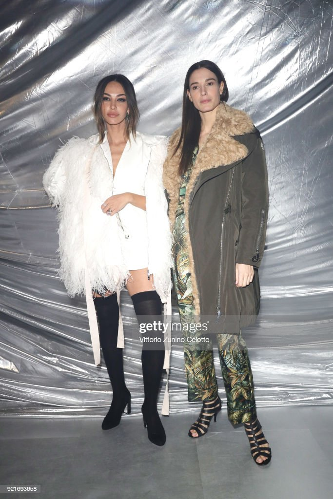 Madalina Ghenea and Chiara Baschetti attend Moncler Genius during Milan Fashion Week on February 20, 2018 in Milan, Italy.