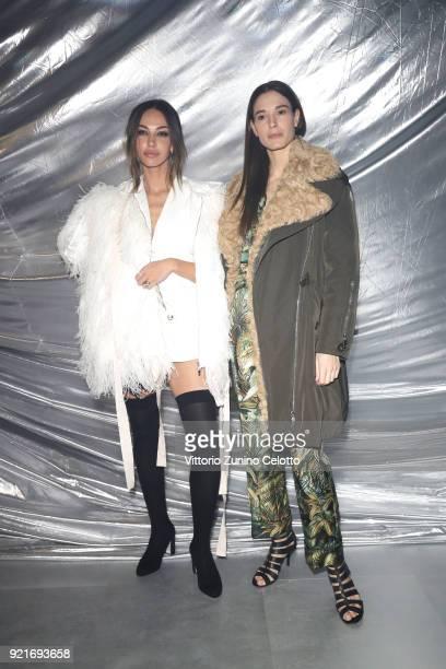Madalina Ghenea and Chiara Baschetti attend Moncler Genius during Milan Fashion Week on February 20 2018 in Milan Italy