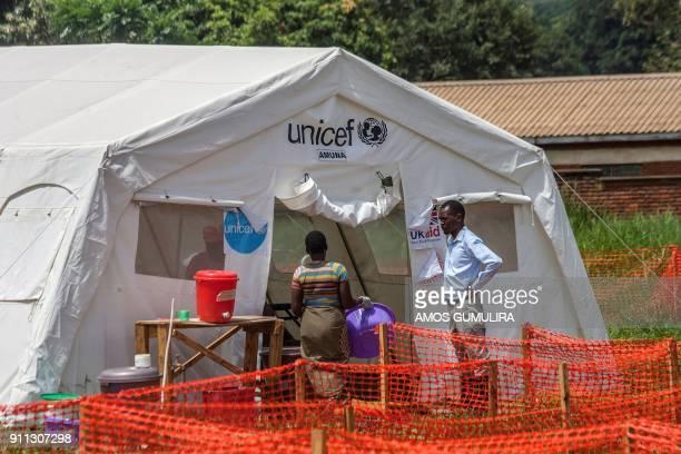 Madalitso Nkhata the Intergrated Disease and Surveillance Cordinator looks at a guardian of a cholera patient as she walks into Cholera Treatment...