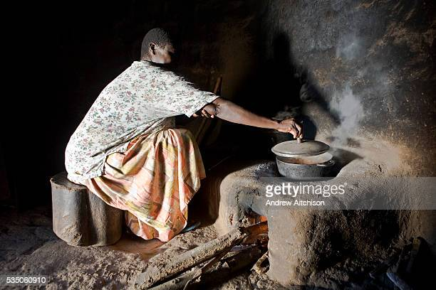 Madam Betty Okiru cooking in a hut using a fuelefficient stove The stove is constructed in a way that uses the least amount of wood a chimney is...