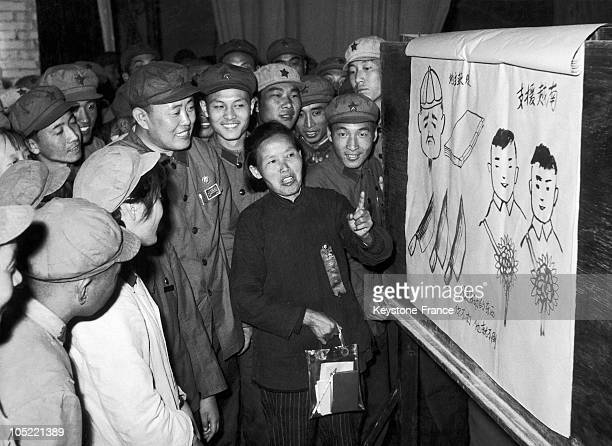 Madam KuAhCat Teaches Extracts Of The Small Red Book Of Mao TseTung To Illiterate Soldiers In Beijing China On December 12 1966 On The Table On The...