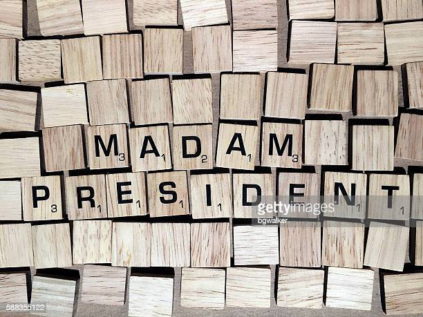 Madam President Spelled with Scrabble Tiles Letters
