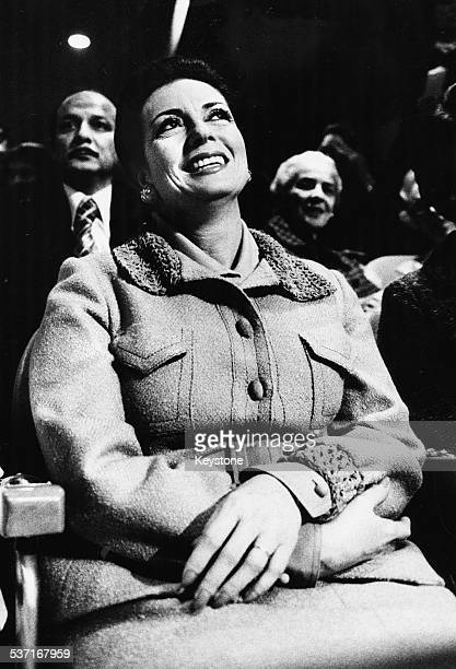 Madam Sadat wife of Egyptian President Anwar Sadat watching her husband deliver a speech at the United Nations New York November 3rd 1975