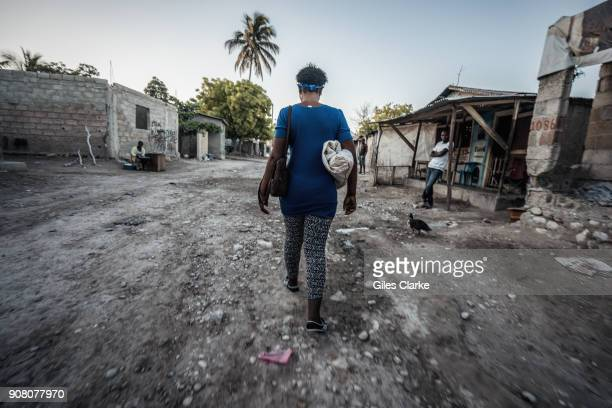 Madam Sara walks to the produce market at the Dominican Republic border Madam Sara's' are the Haitian women who buy and resell products to support...