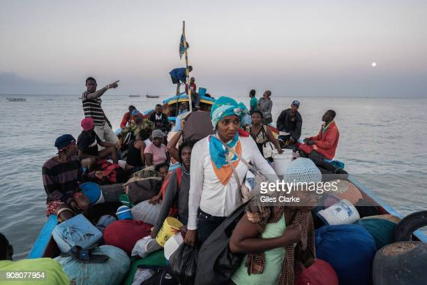 Madam Sara's pack themselves and goods onto wooden cargo boats that sail back and forward from Merigot to AnseAnPitres on the Dominican Republic...